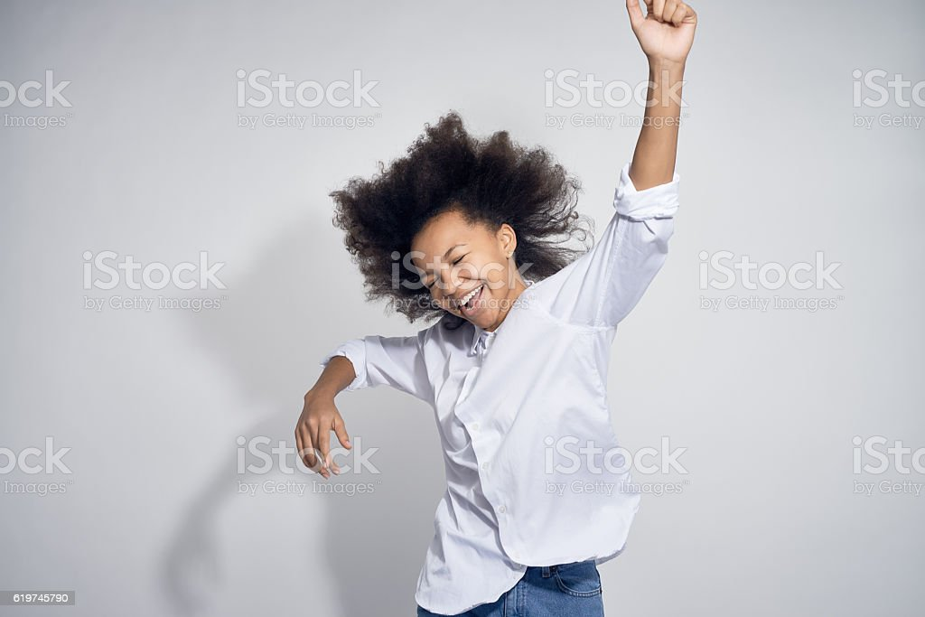 Happy Teenage Girl Dancing stock photo