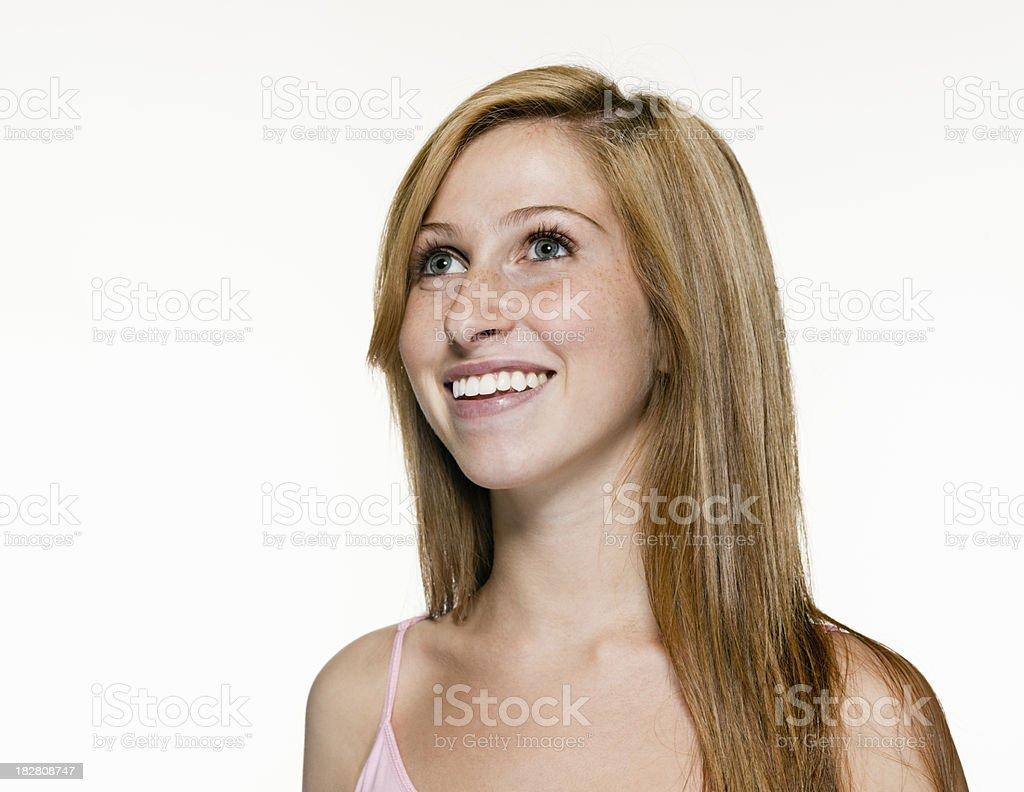 Happy Teenage Girl Looking Up royalty-free stock photo