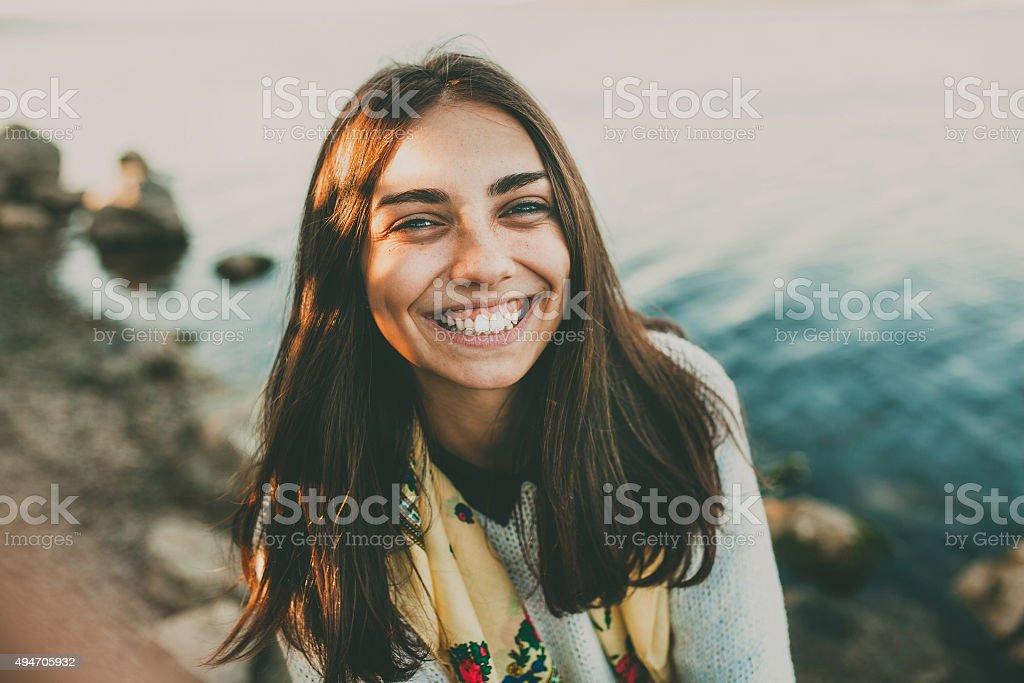 Happy teenage girl outdoors stock photo