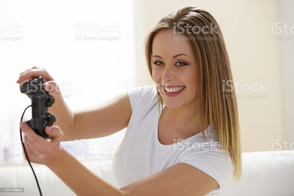Happy teenage girl playing video game royalty-free stock photo