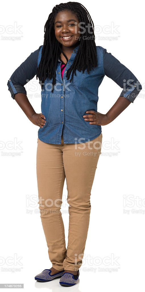 Happy teenage girl standing with her hands on her hips royalty-free stock photo