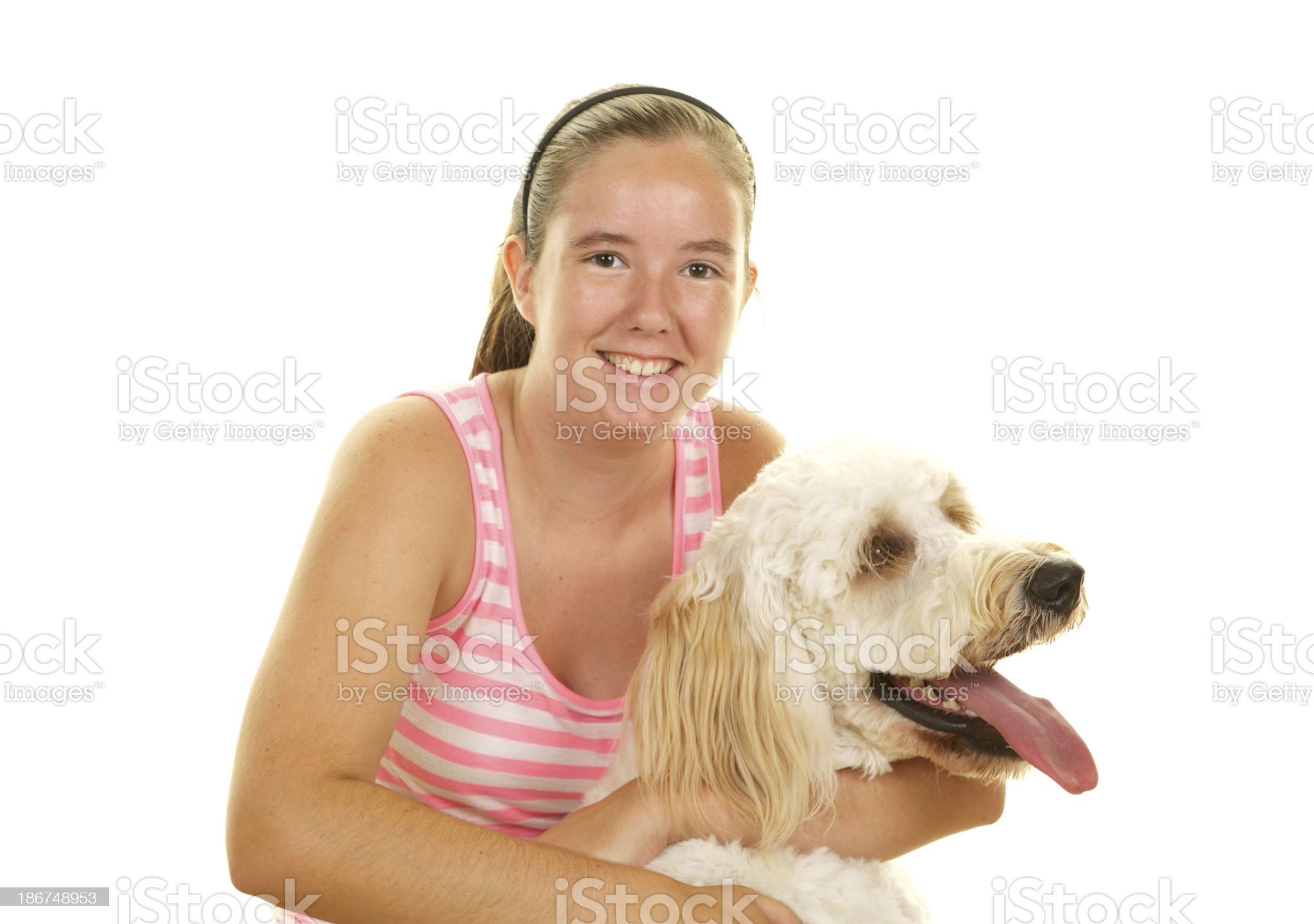 Happy Teenage Girl with her Goldendoodle Dog White Background royalty-free stock photo