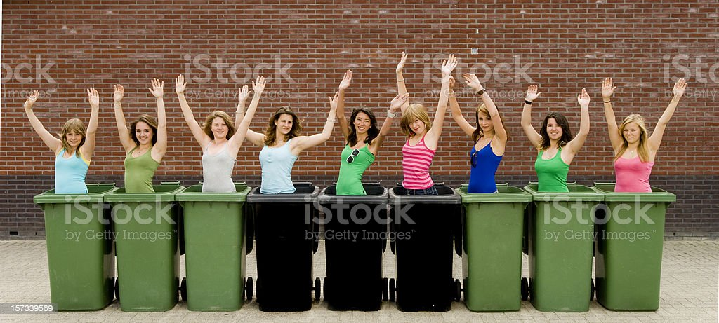 happy teenage girls in garbage containers royalty-free stock photo