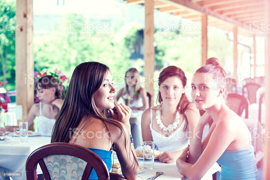 Happy Teenage Girls in Restaurant stock photo
