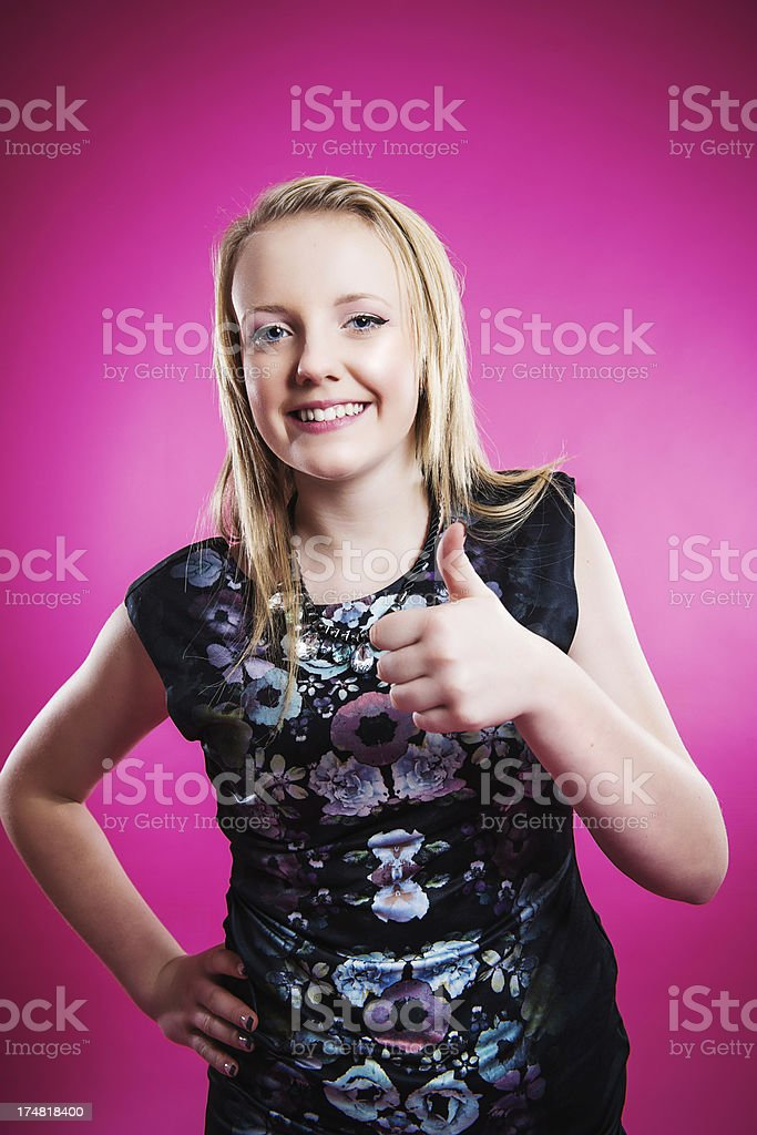 Happy teenager doing thumbs up stock photo