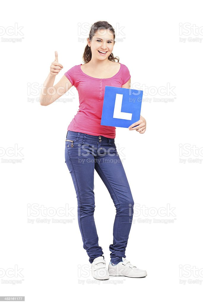 Happy teenager holding L plate royalty-free stock photo