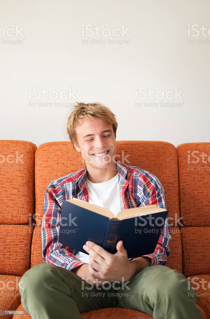 Happy teenager reading book royalty-free stock photo