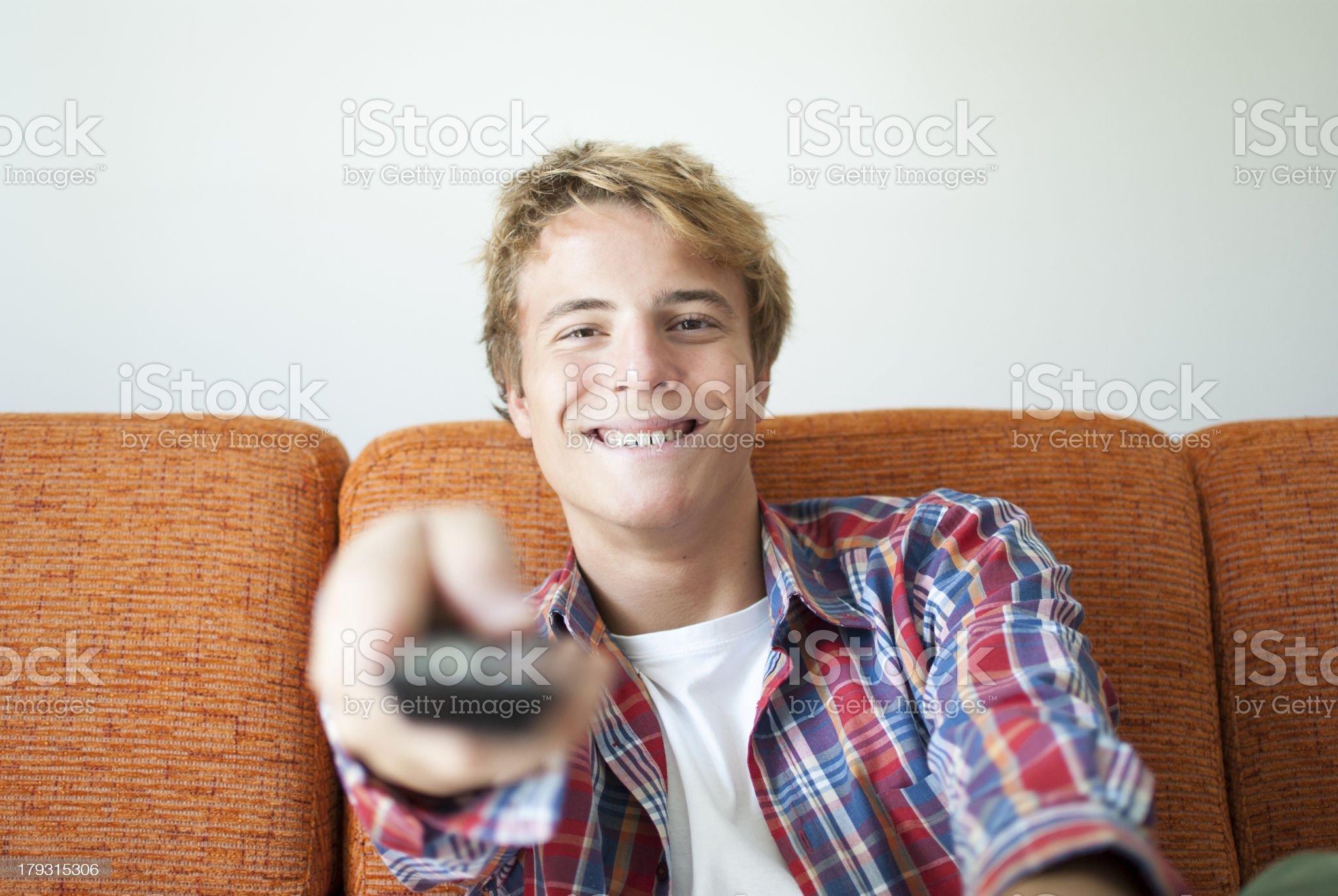 Happy teenager watching tv royalty-free stock photo