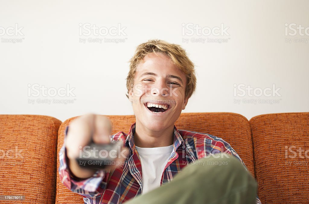 Happy teenager watching tv royalty-free stock photo