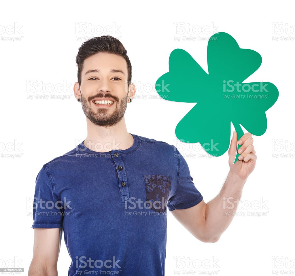 happy teenager with clover stock photo