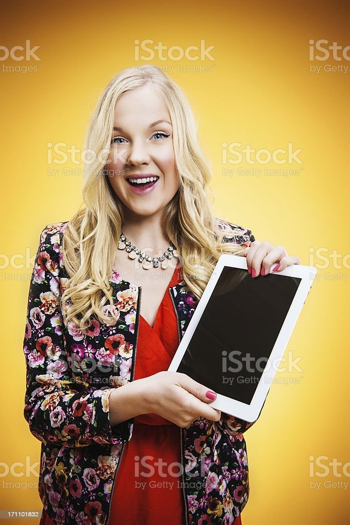 Happy teenager with digital tablet stock photo