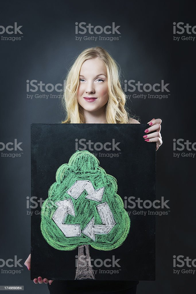 Happy teenager with recycle sign stock photo
