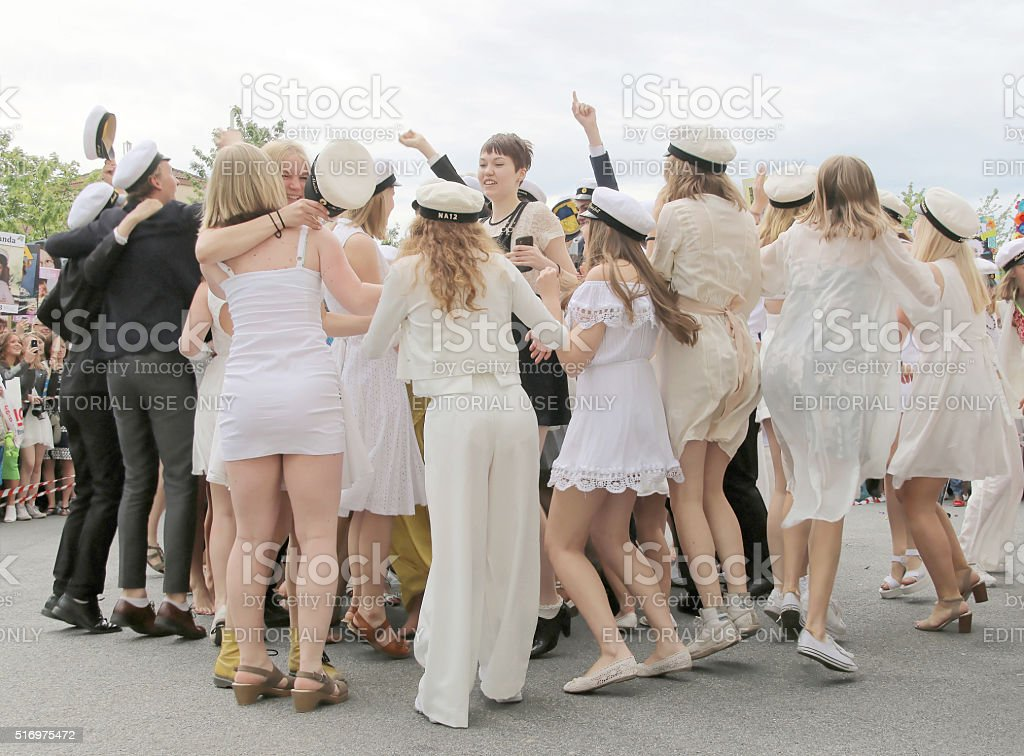 Happy teenagers dancing at the graduation stock photo