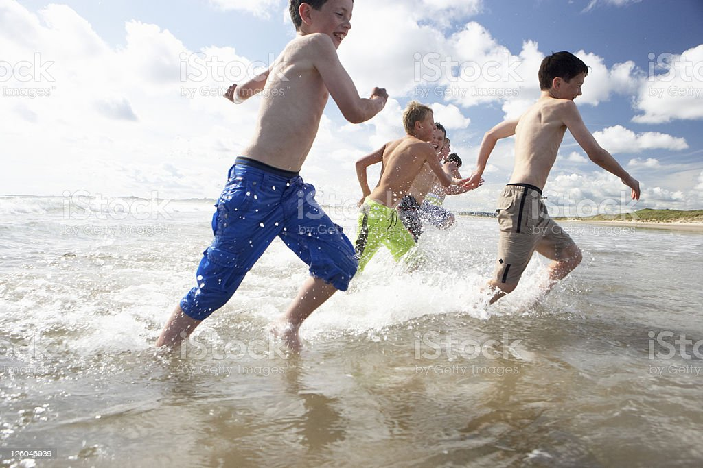 Happy Teenagers playing on beach royalty-free stock photo