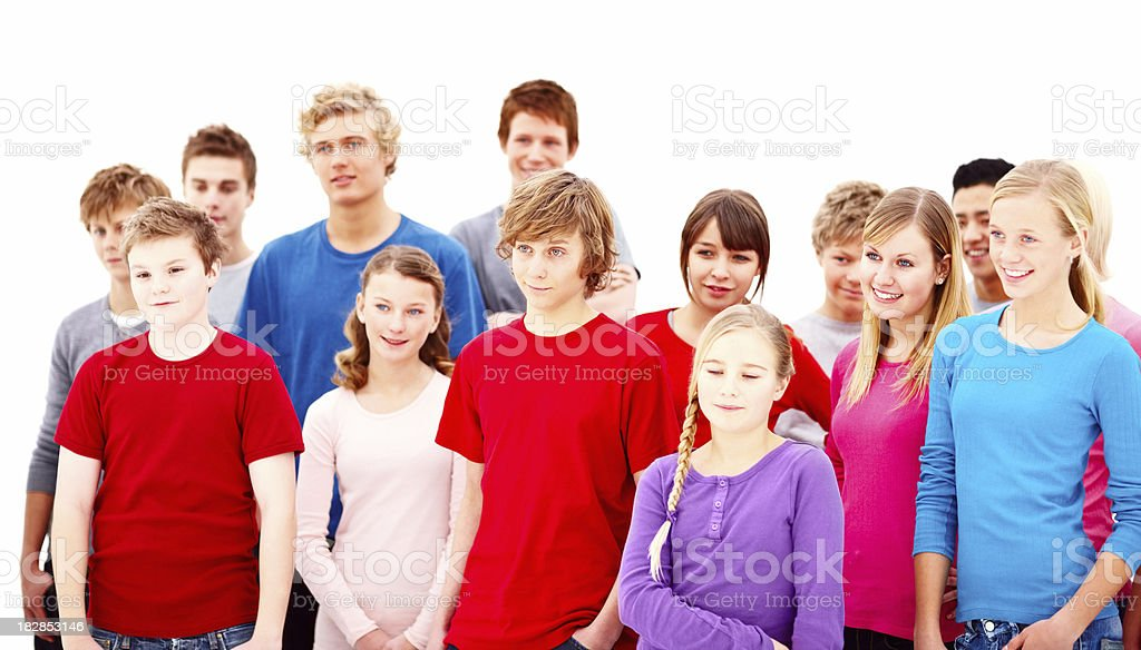 Happy teenagers standing together against white background royalty-free stock photo