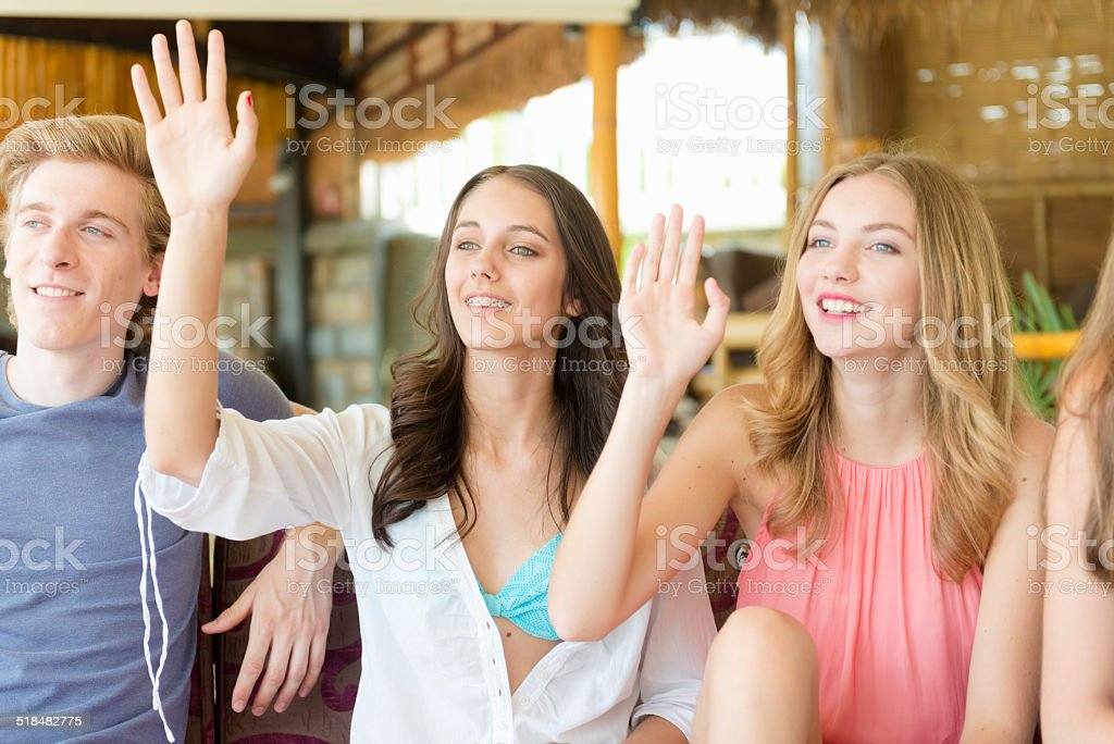 Happy Teenagers Waving at Beach Coctail Club, Europe stock photo