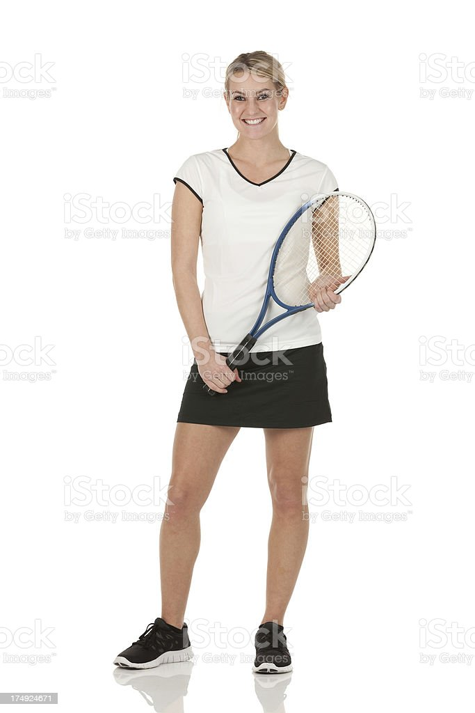Happy tennis player posing with a racket stock photo
