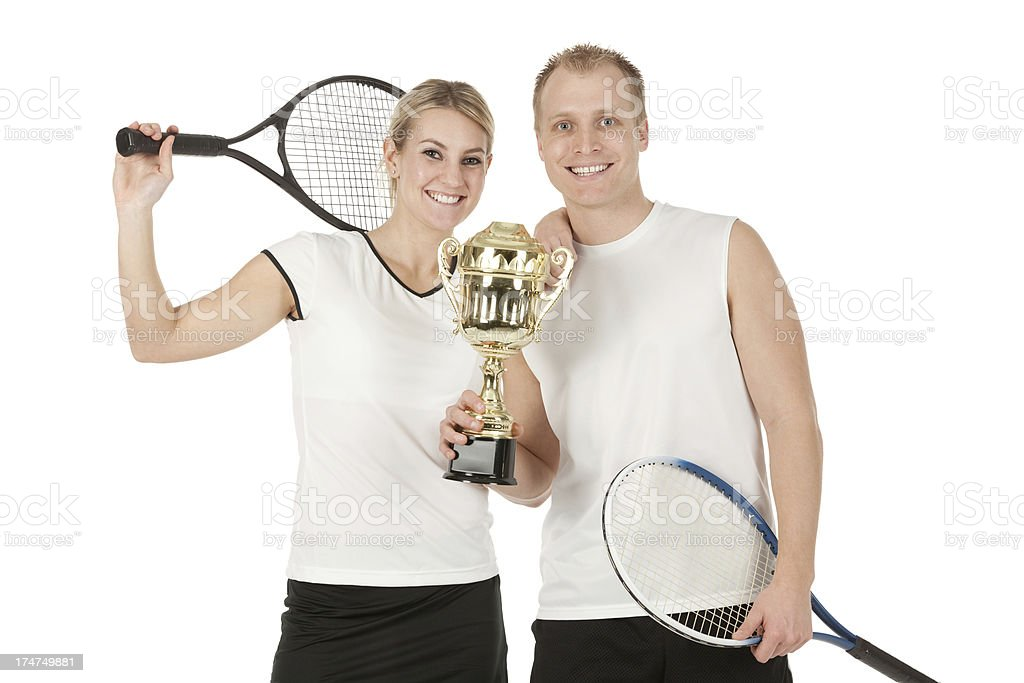 Happy tennis players holding a trophy stock photo