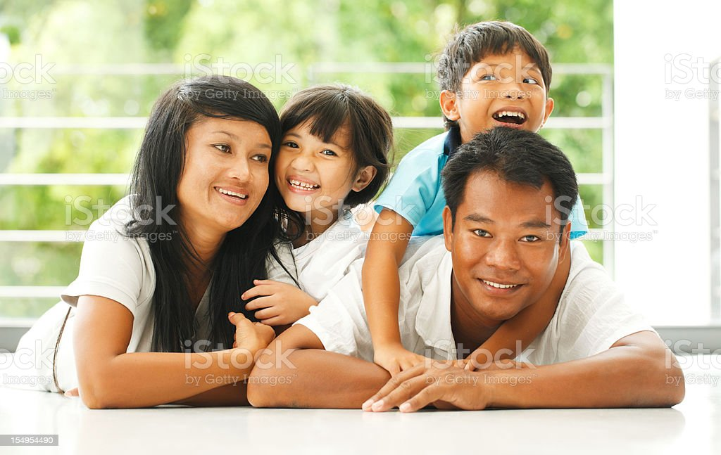 Happy Thai family at home royalty-free stock photo