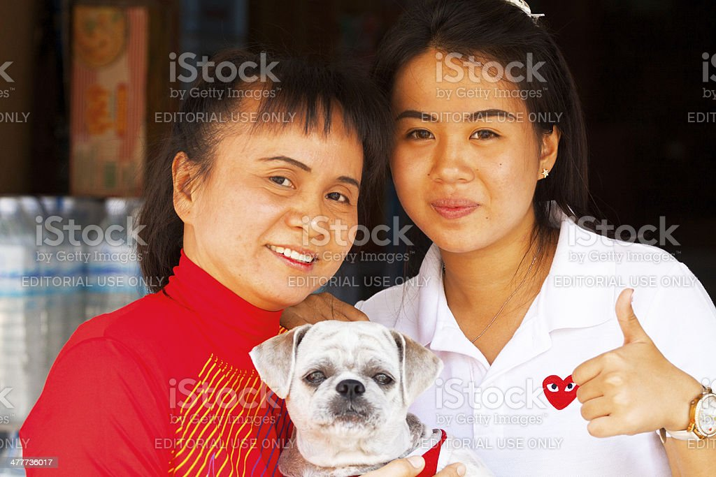 Happy Thai mom and daughter stock photo
