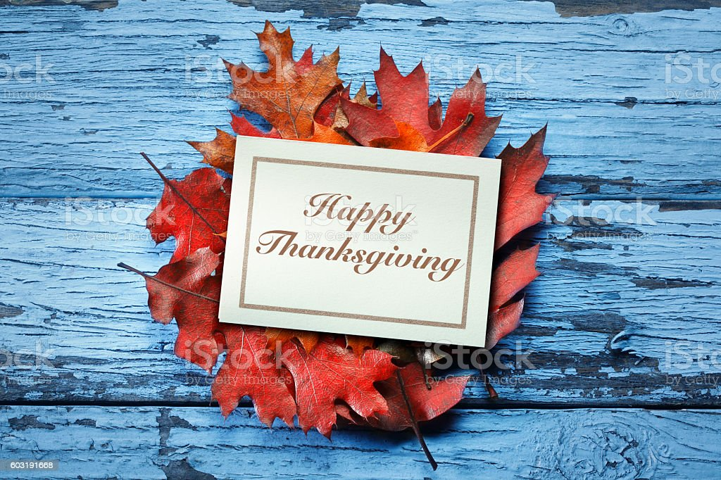 Happy Thanksgiving Card On Fall Leaves stock photo