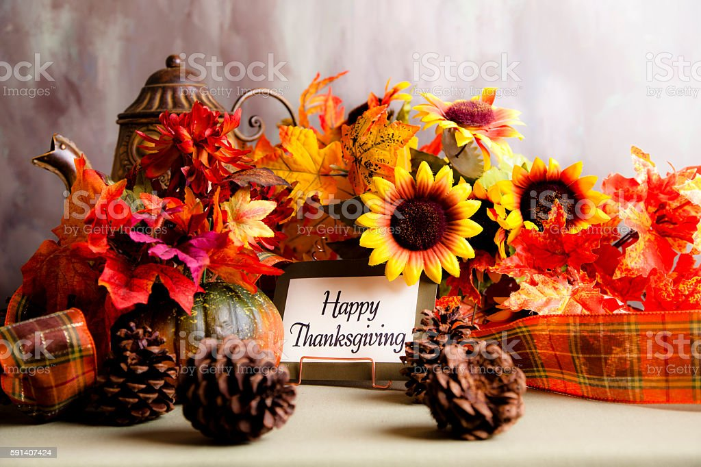 Happy Thanksgiving centerpiece with autumn floral decorations. stock photo