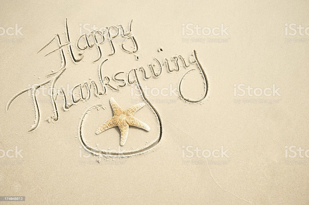 Happy Thanksgiving Message with Decorative Starfish in Sand royalty-free stock photo