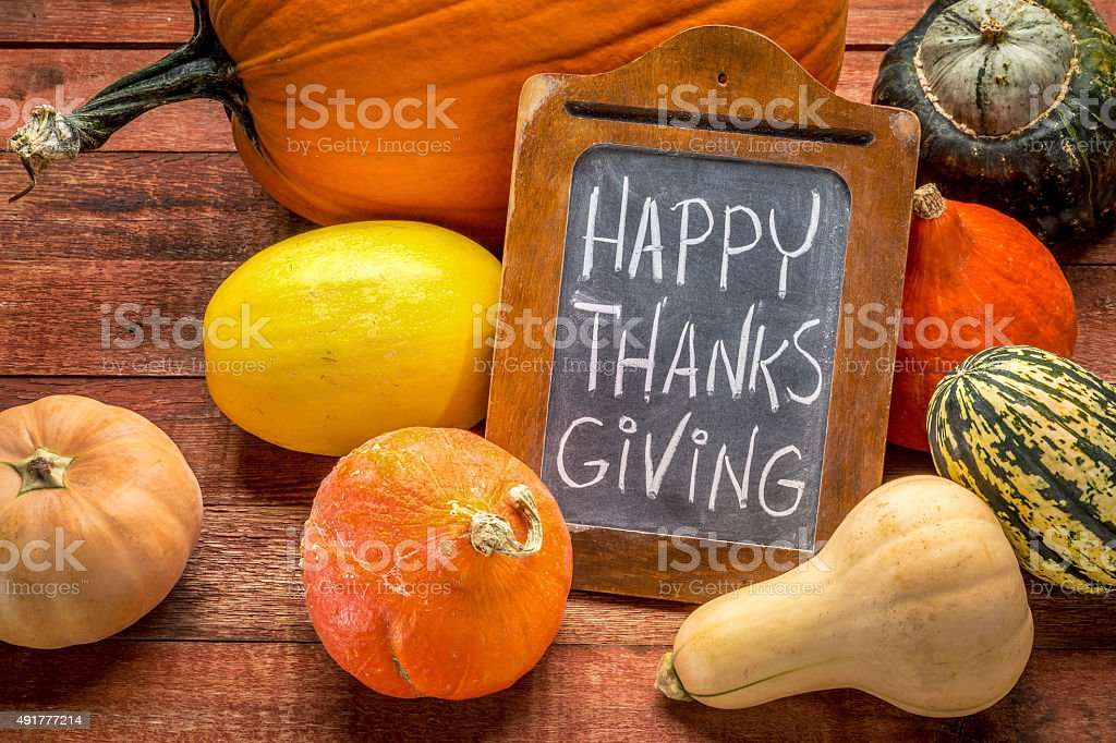 Happy Thanksgiving on blackboard with squash stock photo