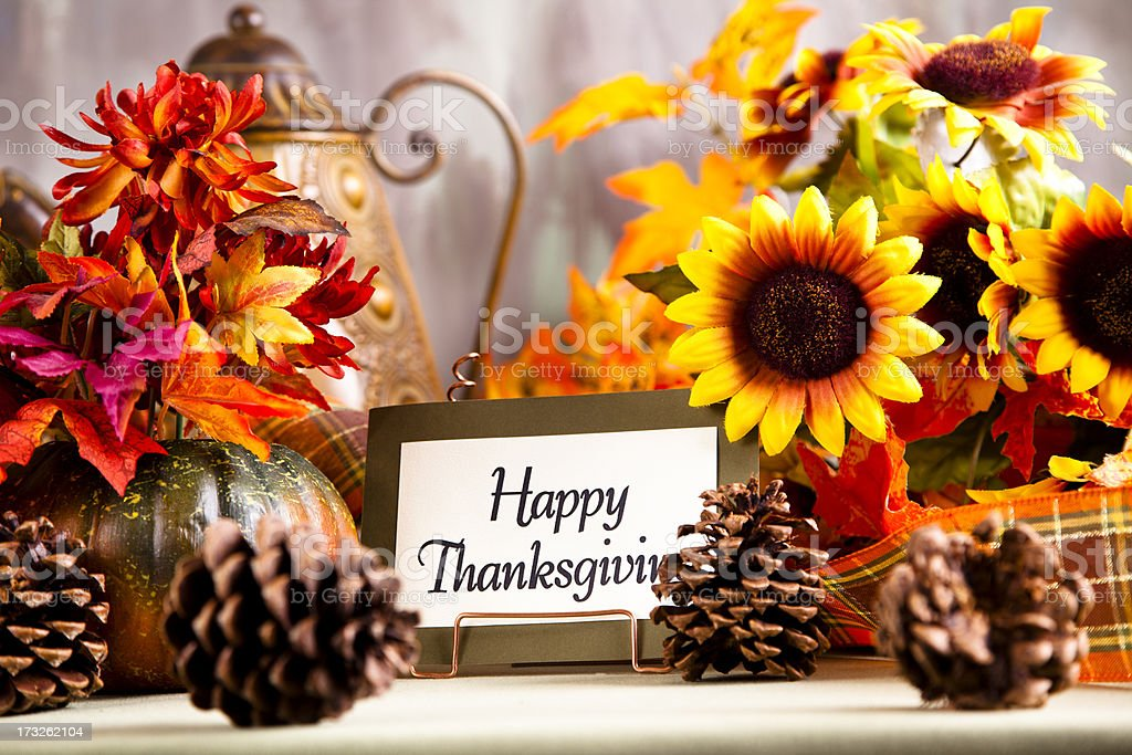 Happy Thanksgiving place setting. Centerpiece, flowers. royalty-free stock photo