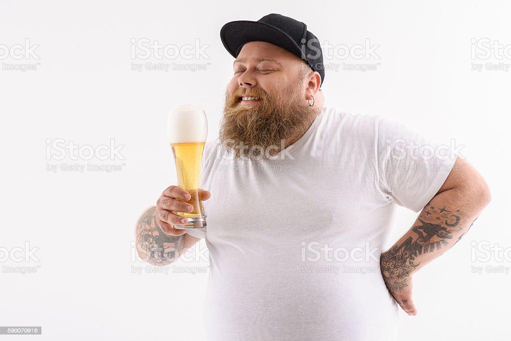 Happy thick guy enjoying alcohol stock photo