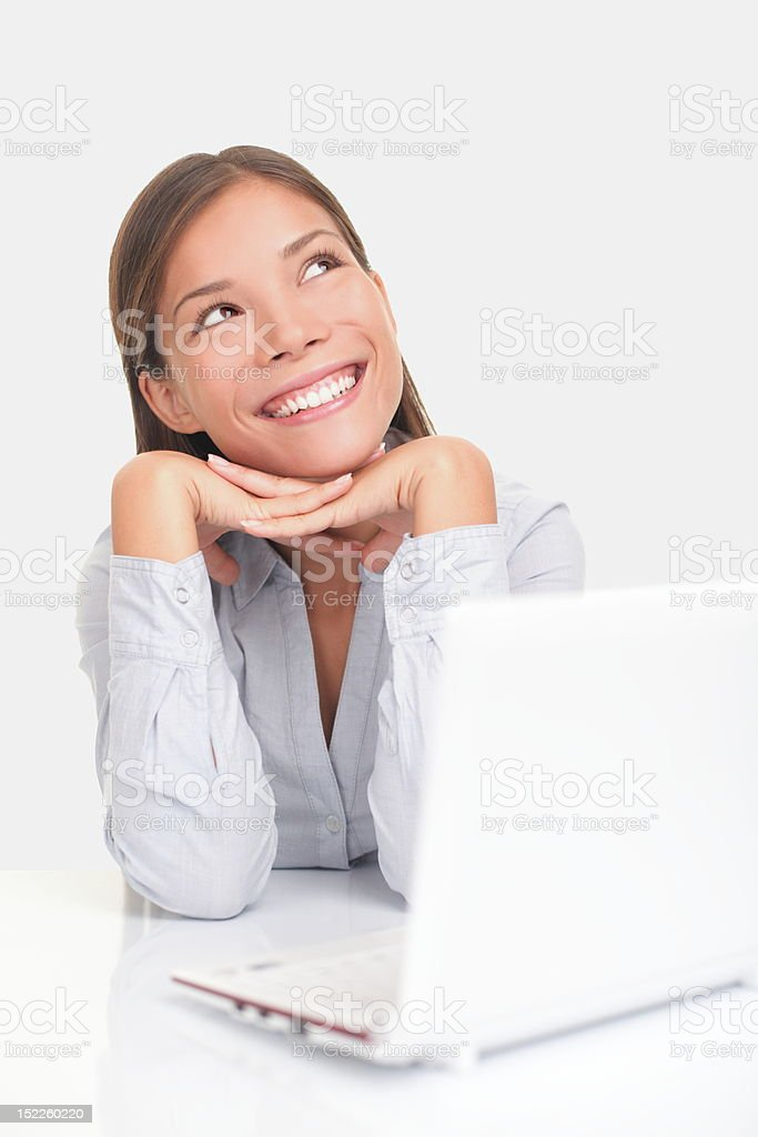 Happy thinking girl with computer royalty-free stock photo