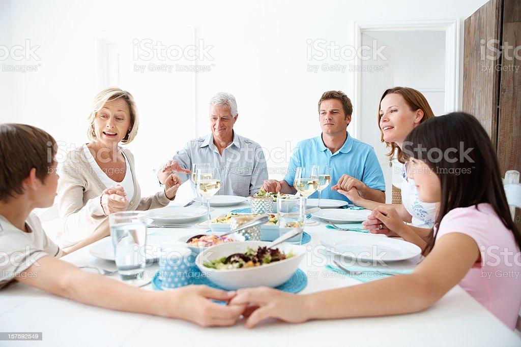 Happy three generational family having a healthy breakfast royalty-free stock photo