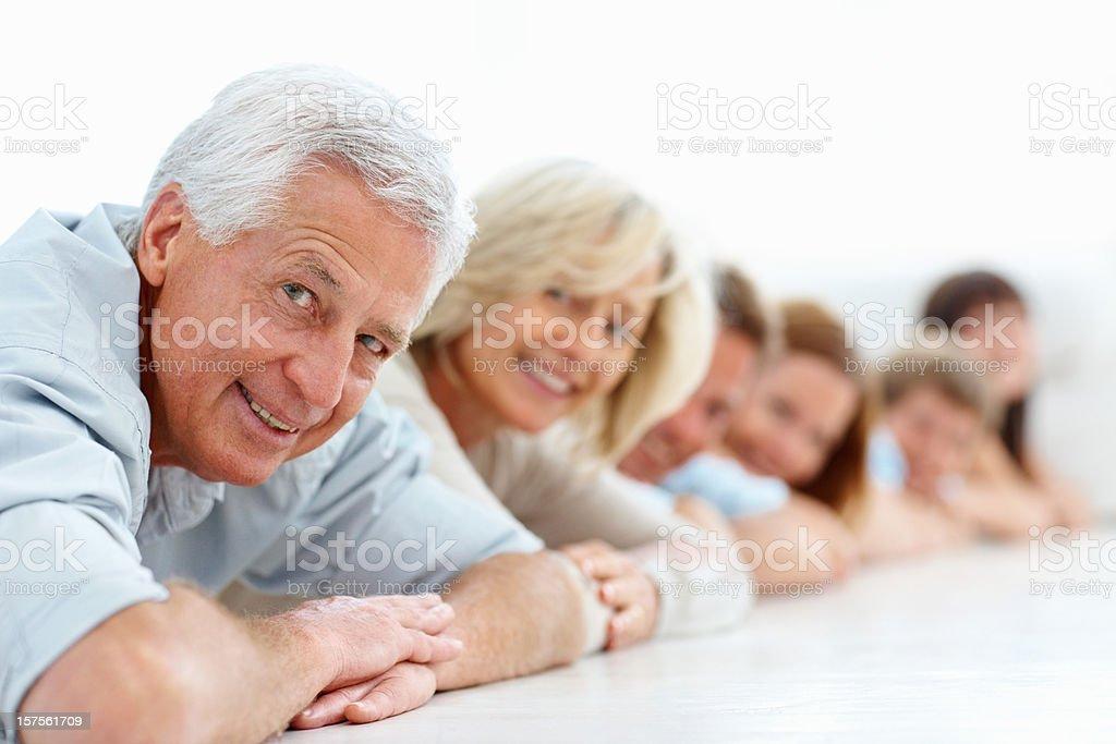 Happy three generational family lying on floor royalty-free stock photo