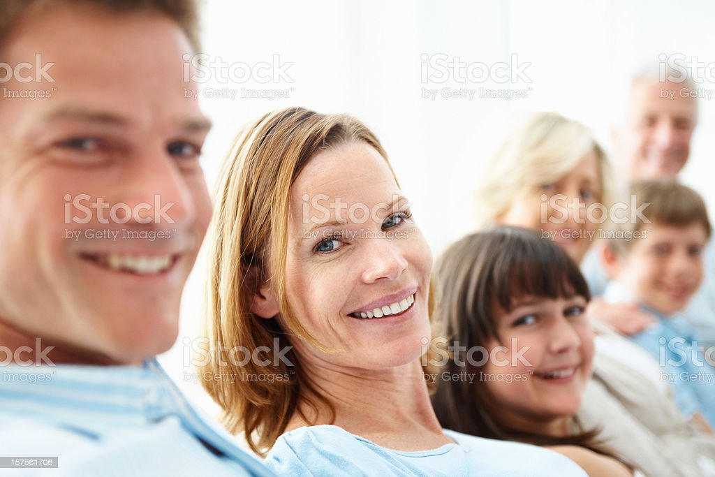 Happy three generational family sitting together at home royalty-free stock photo