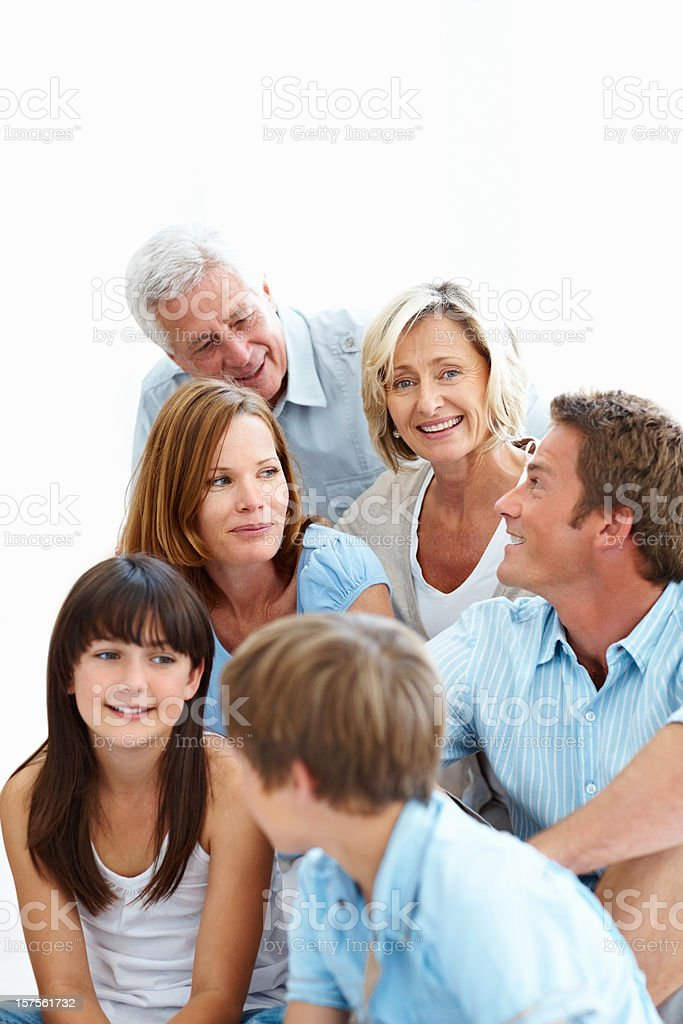 Happy three generational family sitting together royalty-free stock photo
