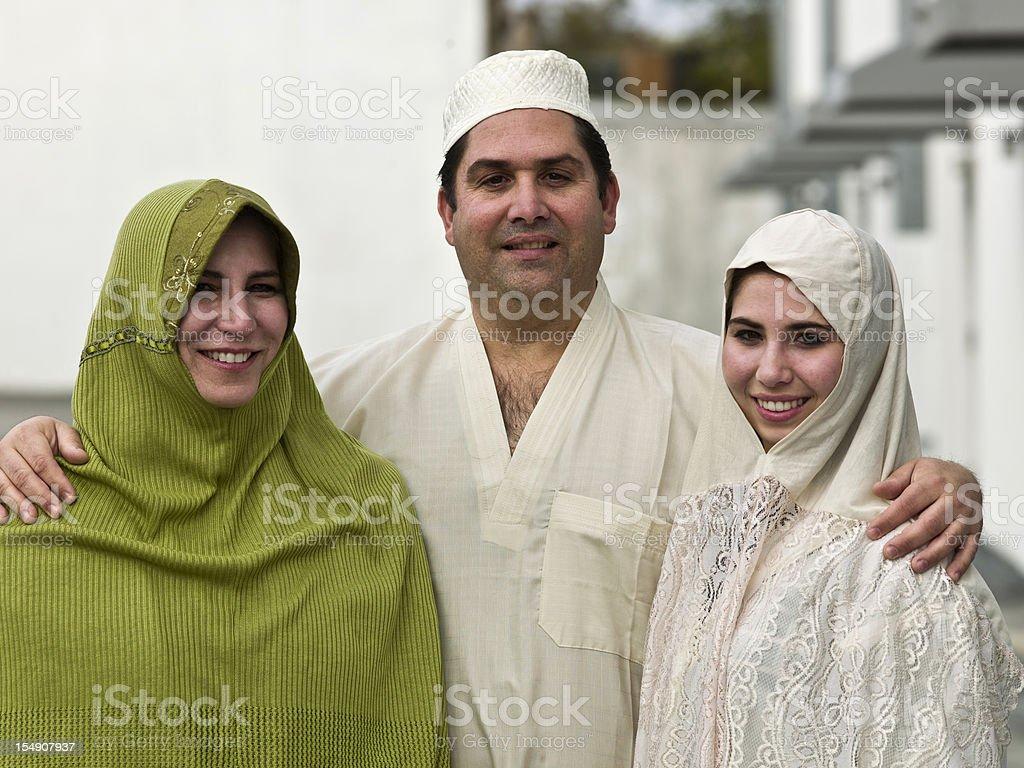 Happy three person Muslim family stock photo