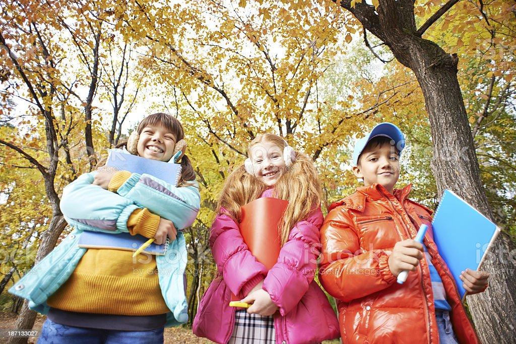 Happy three pupils royalty-free stock photo
