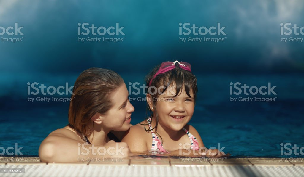 happy time together and swimming pool stock photo