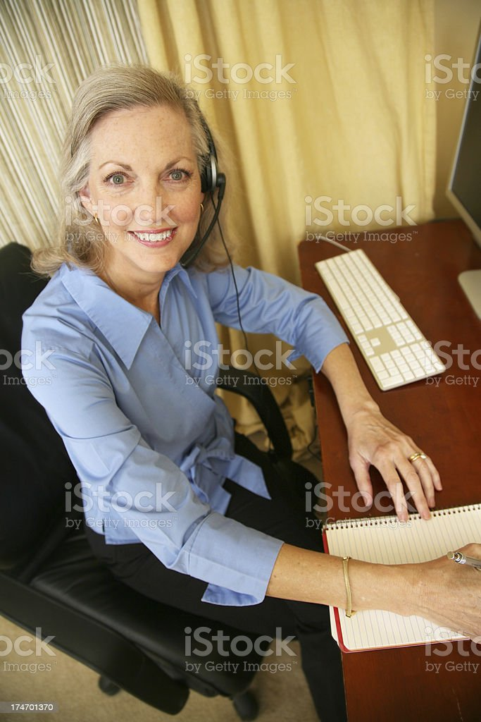 Happy to Serve At Home Customer Service Representative royalty-free stock photo