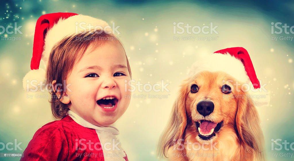 Happy Toddler girl and Dachshund dog stock photo