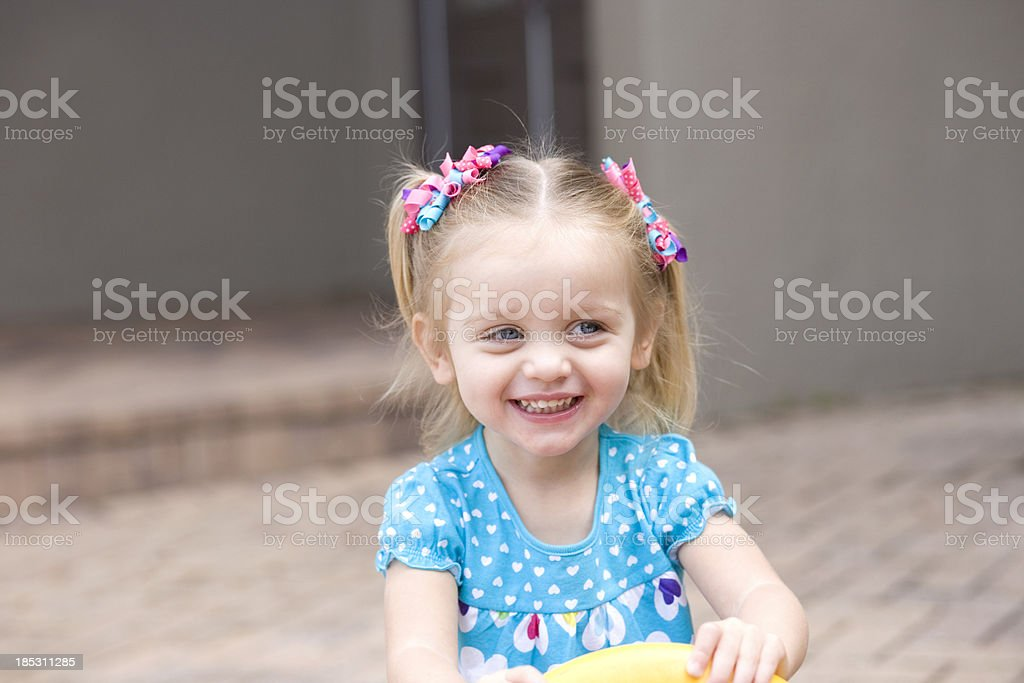 Happy Toddler Girl Playing Outdoors royalty-free stock photo