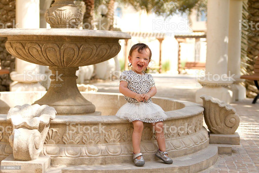 Happy Toddler Girl Sitting Outside stock photo
