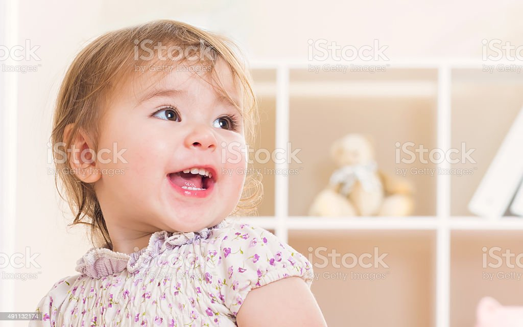 Happy toddler girl with a great big smile stock photo