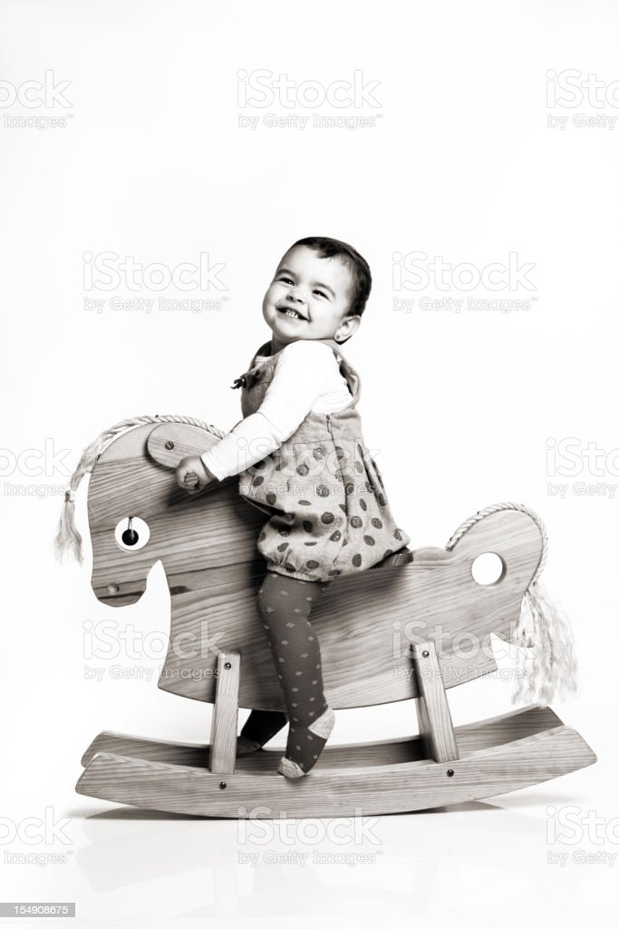 Happy toddler on  wooden horse. royalty-free stock photo