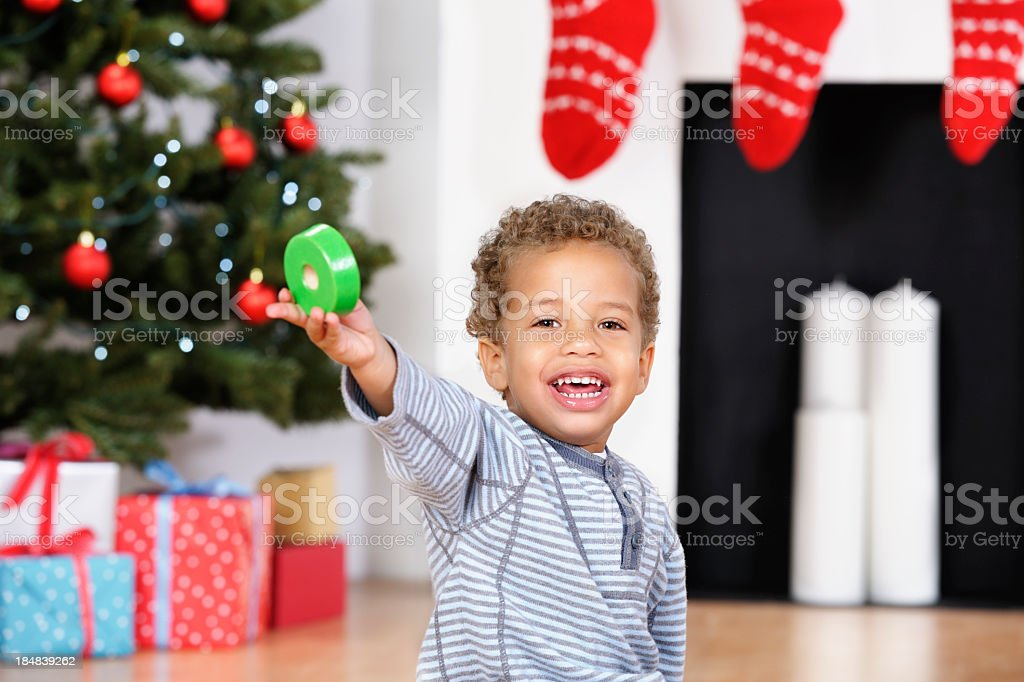 Happy Toddler Showing Off Part Of His Christmas Present stock photo
