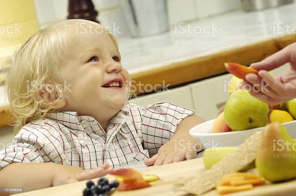 Happy toddler with healthy food royalty-free stock photo