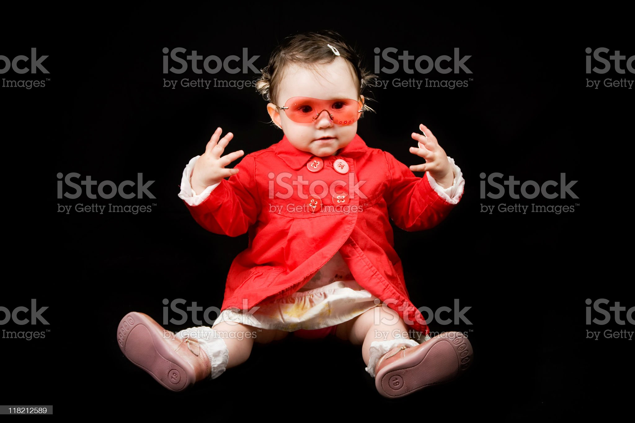 Happy toddler with red jacket and sunglasses royalty-free stock photo