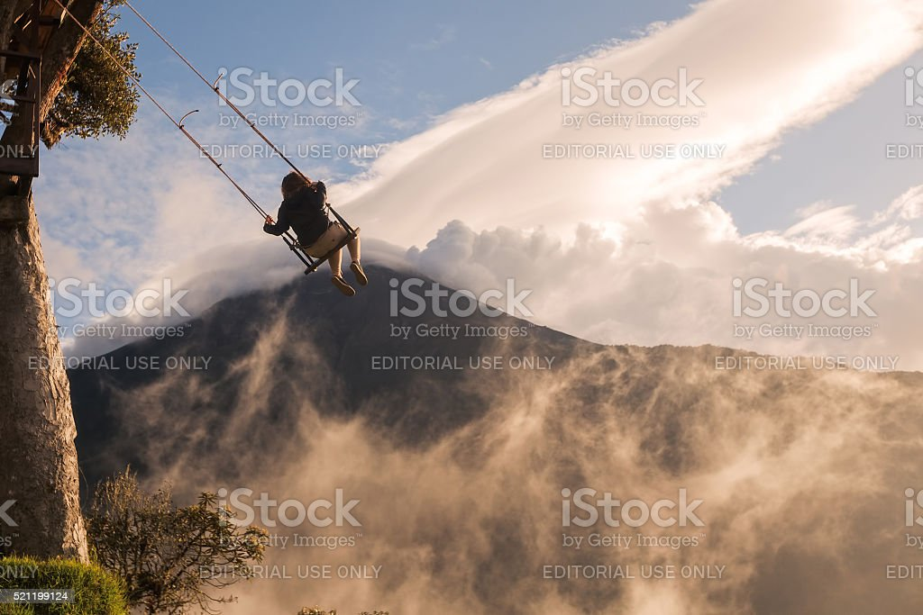 Happy Tourist Girl Swinging On A Swing stock photo