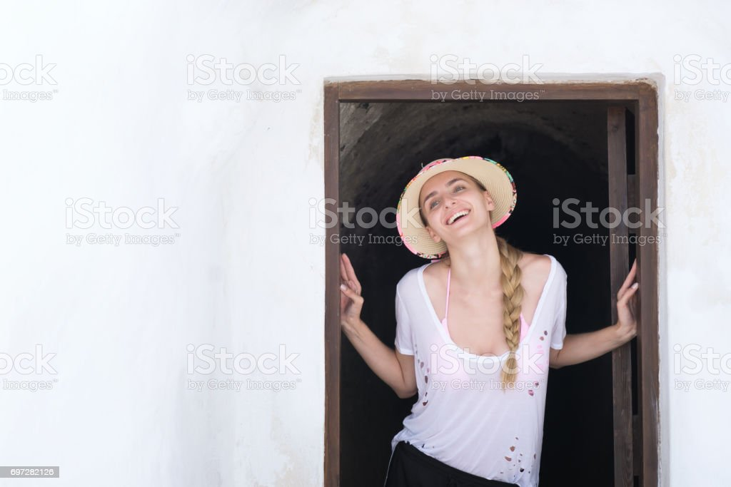 Happy tourist in front of a cellar stock photo