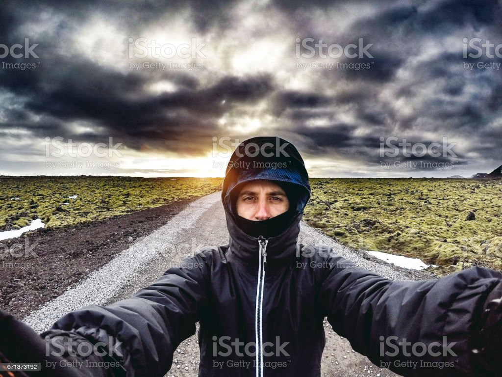Happy tourist in Iceland jumping in the middle of nowhere stock photo